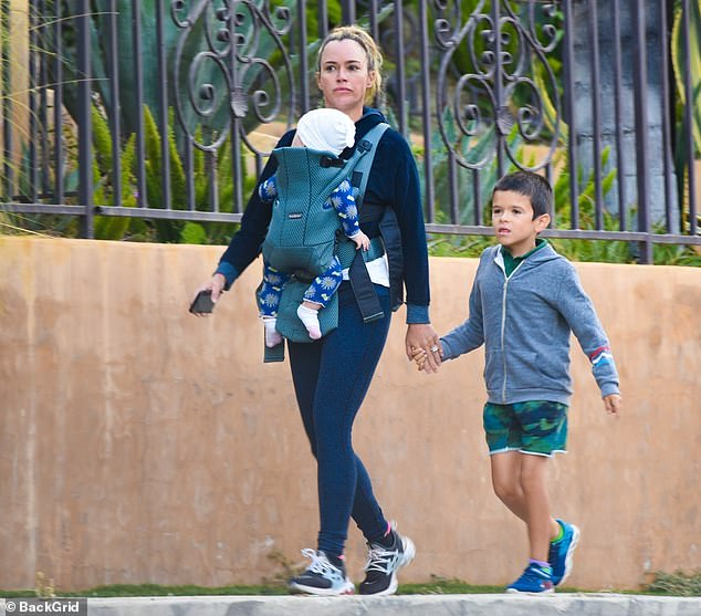 Doting mom: The Teddi Tea Pod podcast host looked fresh-faced, as she slipped into a pair of form-fitting leggings and and a sweatshirt for her Wednesday excursion