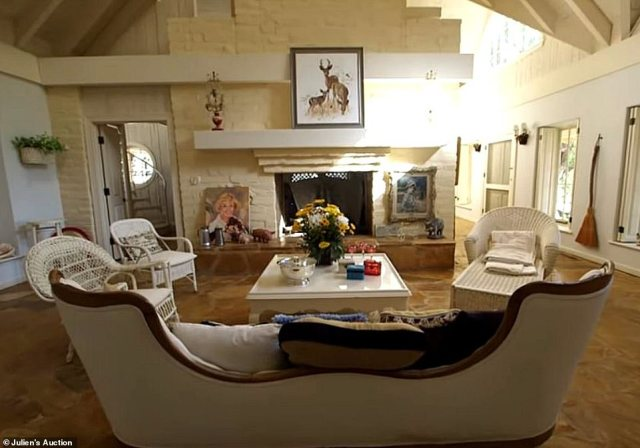 The main bedroom features its own living room and a fireplace. Day lived here for almost four decades