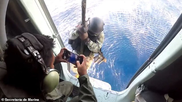 A Mexican soldier is lowered to a speedboat that was intercepted Tuesday in Mahahual, Quintana Roo. The military confiscated a $142 million shipment of cocaine and arrested three individuals