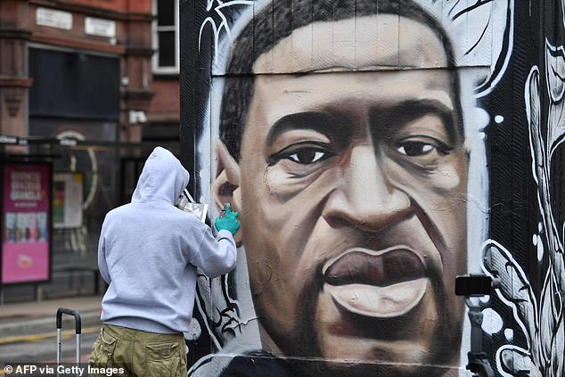 The documentary airs 100 days after the murder of George Floyd, an unarmed black man who was killed by police in Minnesota earlier this year. Pictured, a memorial to Floyd in Manchester
