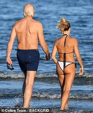 Outside: he enjoyed a swim in the ocean with his partner
