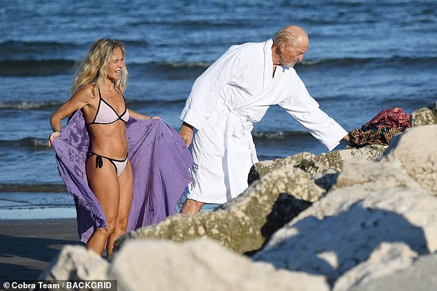 Slender: Her younger companion showed off her tanned physique in the simple bikini