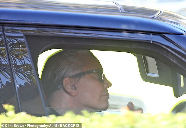 Shotgun: Her husband Ozzy Osbourne sat in the passenger seat of their ride, reportedly blowing smoke out of the window as Sharon did some shopping