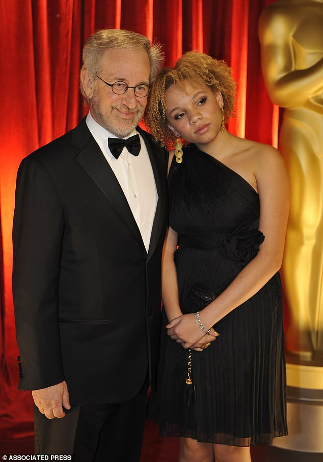 Mikaela, pictured with Steven Spielberg (left): 'Someone tried to make money off a black woman's extreme vulnerability and all I heard was silence, even applause for the fact that I'd lost part of my ability to connect with others for stability'
