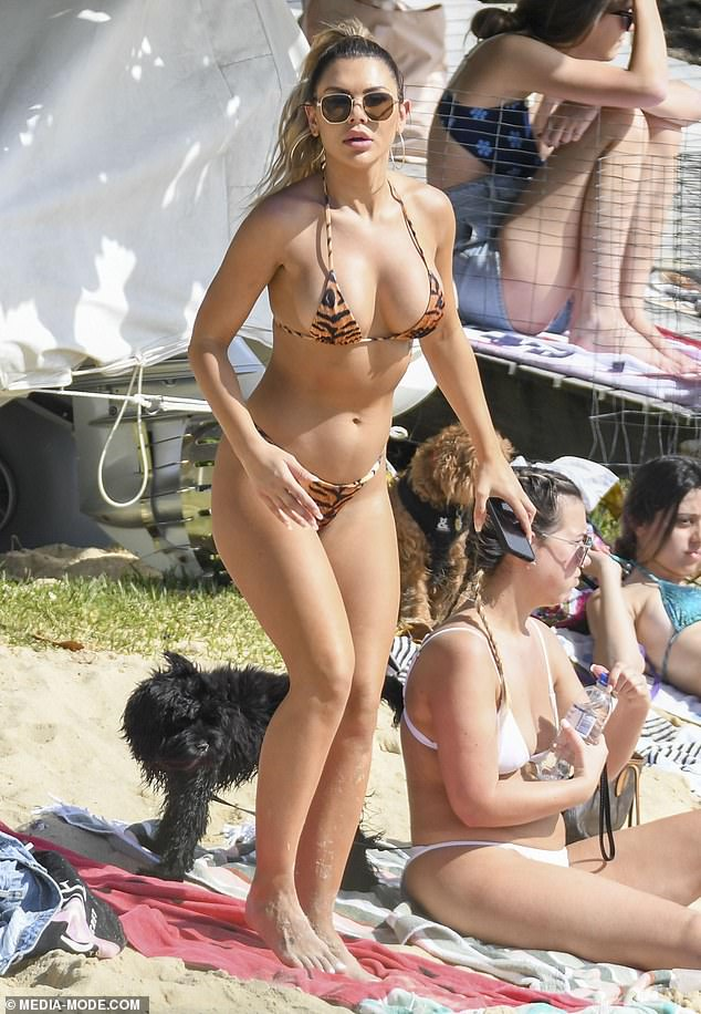 Easy, tiger! Kirralee 'Kiki' Morris showed her ex Ciarran Stott what he's missing as she stripped down to a bikini at Kutti Beach in Vaucluse, Sydney, on Thursday