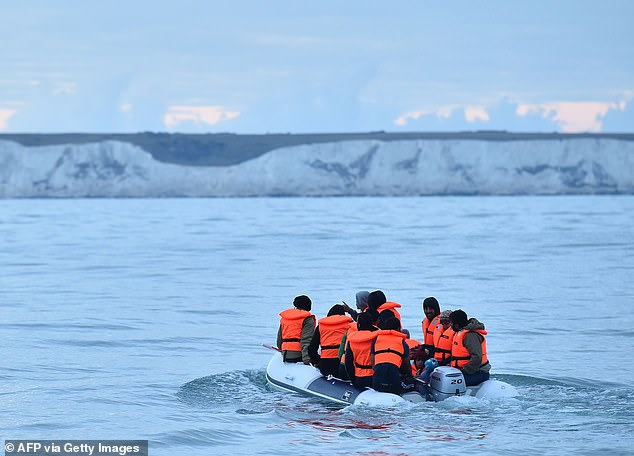 Around 2,500 of this year's 5,500 arrivals have had their claims assessed yet only 20 per cent were successful (pictured, migrants in a dinghy sail towards south coast of England)