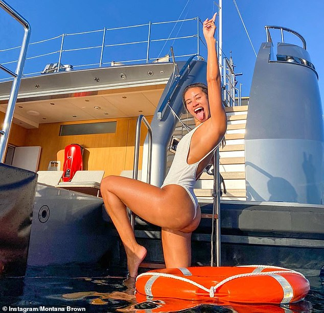 Fun in the sun: On Wednesday Montana sent temperatures soaring as she slipped into a plunging white swimsuit while enjoying her boat trip