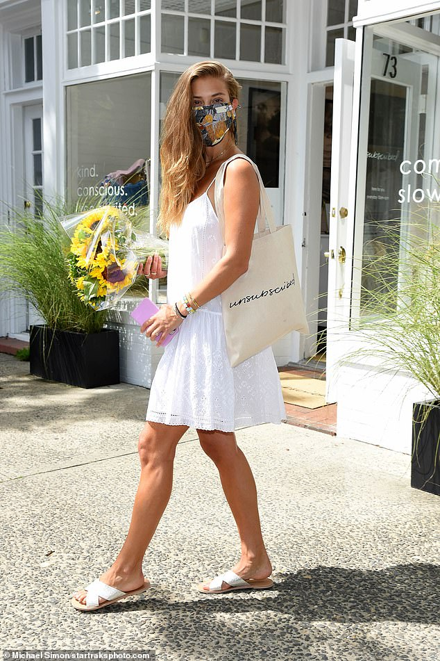 Summertime: The 28-year-old Danish model embraced the summertime weather as she donned a chic white summer dress for her outing