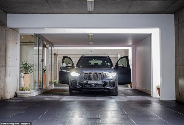 The house also has two double garages joined by an undercover passage dubbed 'The Bunker', which offers parking for another four cars (garage pictured)
