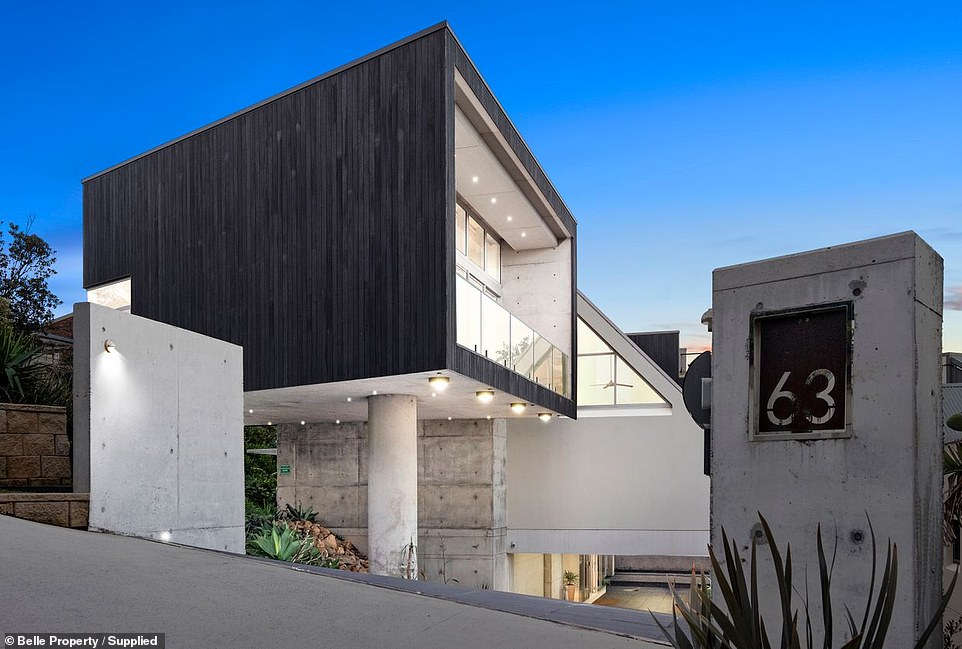 Built 10 years ago on Forresters Beach, between Terrigal and Bateau Bay, the unusual property is split across three stylish levels (exterior pictured from the side)