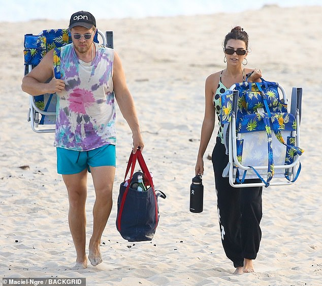 Got their fill:Once they got their fill of the sand, Emily and Sebastian, with their beach gear in hand, made their way back to the bike rack