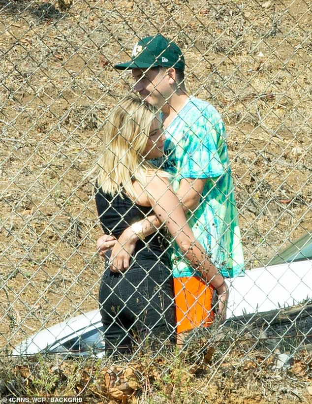 PDA: Ashley Benson and G-Eazy looked closer than ever on Thursday, with the couple snapped kissing and hugging in Mailbu