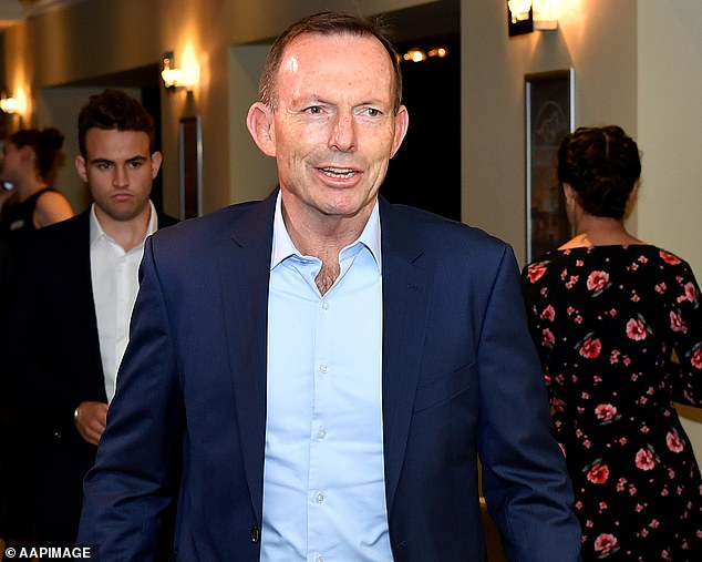 The former Australian prime minister was branded a 'misogynist, a sexist and a climate change denier' by Scottish First Minister Nicola Sturgeon on British morning television (pictured: Tony Abbott arrives at a book launch in Sydney, Monday, November 25, 2019)