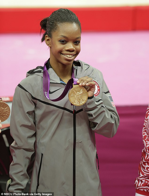 Years of damage: 'From a very young age i always had to put my hair in a tight ponytail to do gymnastics and due to that my hair became completely damaged,' began the 24-year-old Olympian in her post's lengthy caption; Gabby pictured in 2012
