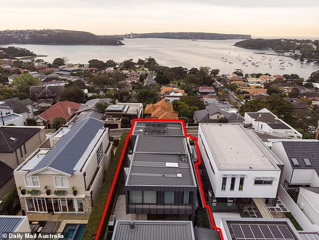Gu's four-bedroom five-bathroom Mosman home (marked in red) overlooks Balmoral with views to North Head. On Friday the house was empty and locked securely