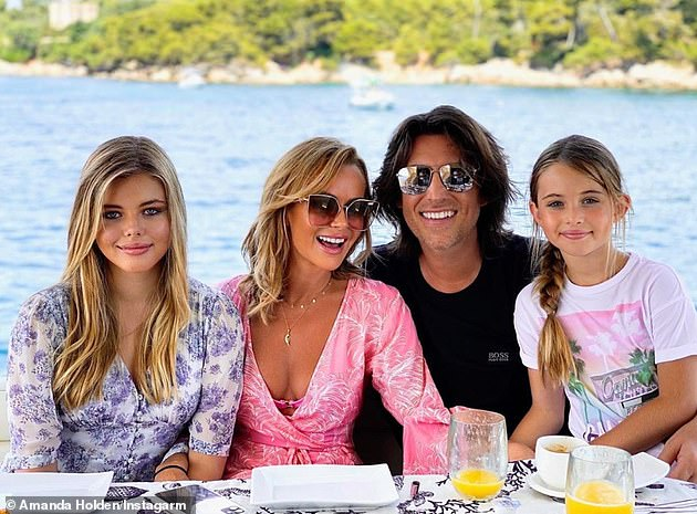 Family first: The broadcaster and her husband Chris Hughes are parents to daughters Lexi, 14, and Hollie, eight (pictured this summer)