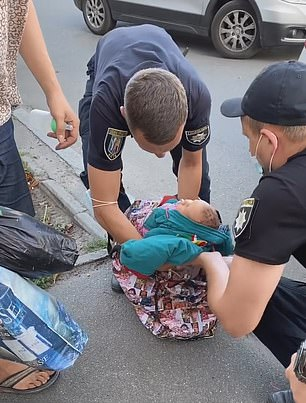 The mother can be heard saying to cops: 'Leave him [the baby] alone. He is alive. He is fine.'