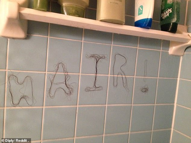 Bathroom battleground! One person who had enough of cleaning up after others in their household, used the hair from the plughole to leave a message