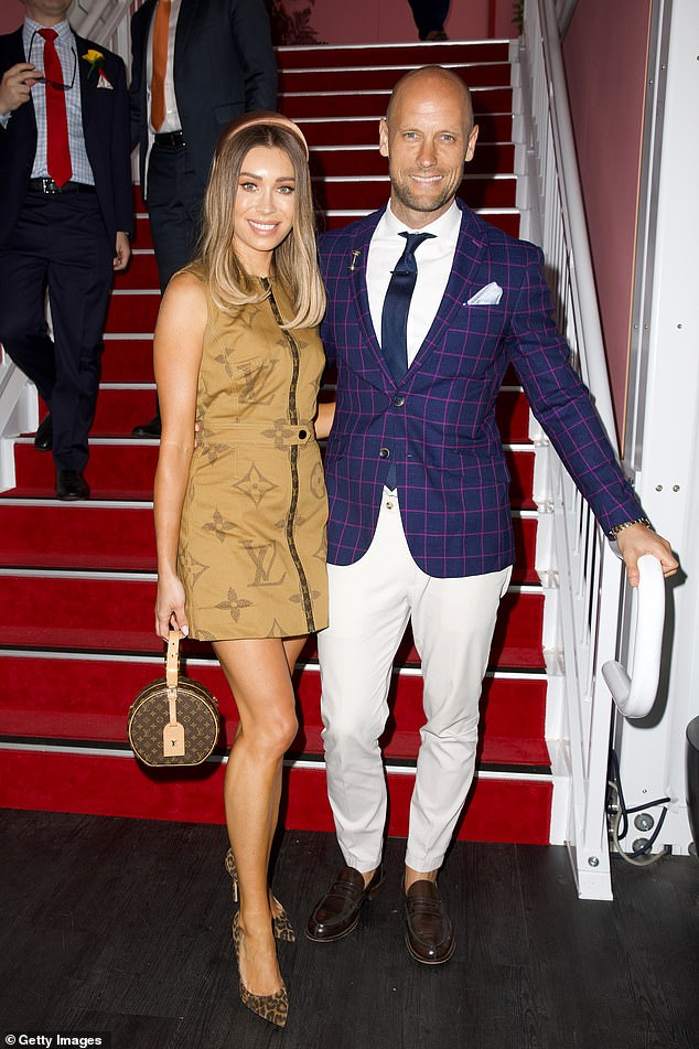 Nick and Rozalia Russian attend Melbourne Cup Day at Flemington Racecourse in 2019