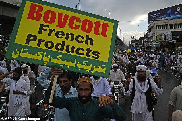 Supporters of hardline Islamist party Tehreek-e-Labbaik Pakistan carry placards and shout slogans during a protest against the reprinting cartoon of the Prophet Mohammad by French magazine Charlie Hebdo, in Rawalpindi on Friday