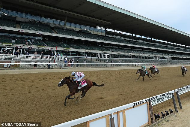 Tiz the Law (8) with Manuel Franco up, wins the 152nd running of the Belmont Stakes in front of a mostly-empty grandstand at Belmont Park
