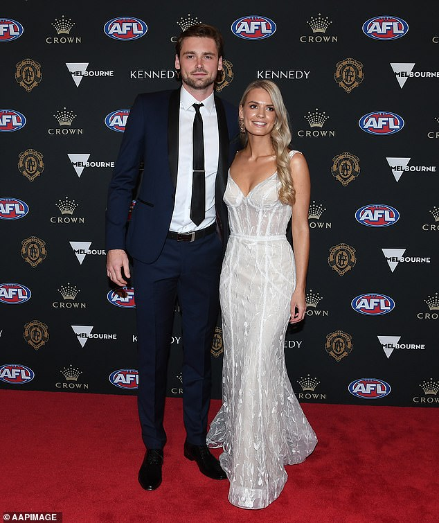 Frematle Dockers' Joel Hamling and his partner Lily Pittard at last year's Brownlow ceremony in Melbourne. This year will be a 'hybrid event' featuring virtual crosses to adapt to the COVID-19 pandemic