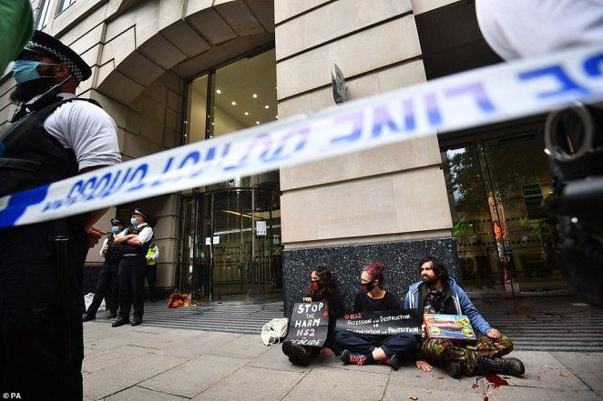 Police cordon off protesters who have glued themselves to the pavement.Earlier on Thursday, some protesters glued themselves to the ground around Parliament while others staged a sit-in elsewhere around the perimeter