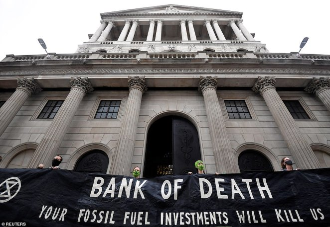 Protesters hold a banner that reads 'bank of death your fossil fuel investments will kill us' outside the Bank of England as part of demonstrations