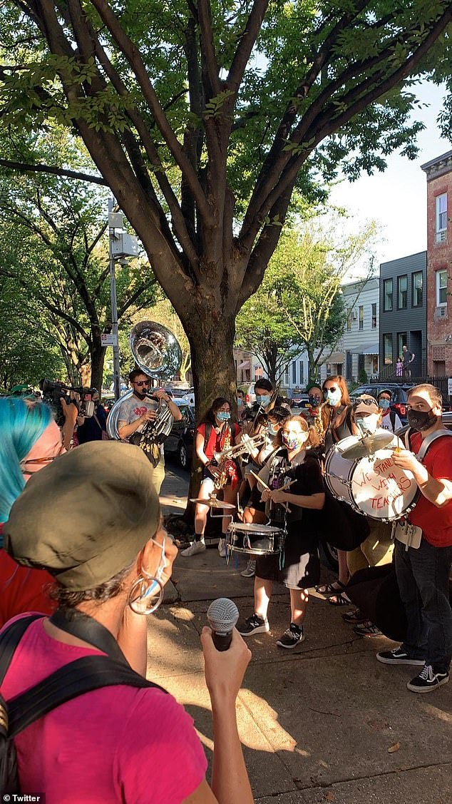 Pictured: the group of educators played drums, horns and other instruments early Friday morning to kick off their demonstration