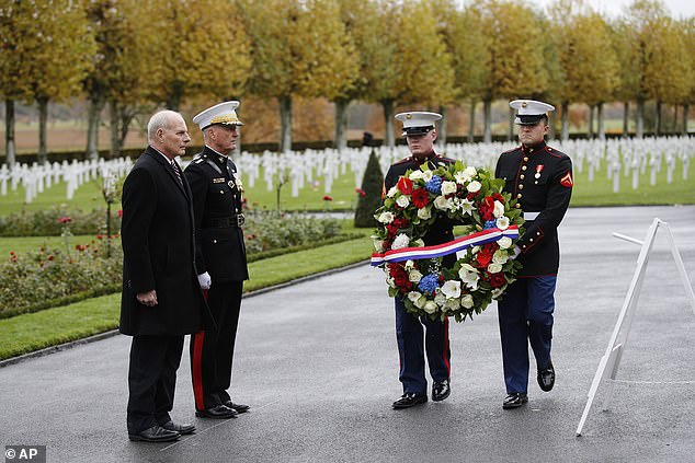 White House Chief of Staff John Kelly, left, and Chairman of the Joint Chiefs of Staff, Marine Gen. Joseph Dunford attend a ceremony at the Aisne Marne American Cemetery near the Belleau Wood battleground, in Belleau, France, Saturday, Nov. 10, 2018. Belleau Wood, 90 kilometers (55 miles) northeast of the capital, is the place where U.S. troops had their breakthrough battle by stopping a German push for Paris shortly after entering the war in 1917. Trump did not attend as planneed