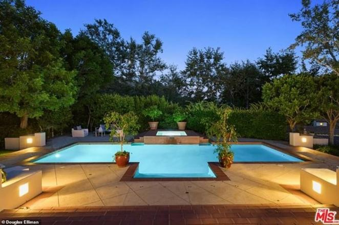 Outdoor lovers: The exterior is just as lavish, with manicured lawns, lush gardens and several tiled fountains