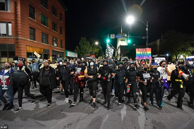 Around 1,000 anti-racism protesters were seen at the event on Friday, with many of them carrying signs and chanting 'Black Lives Matter'