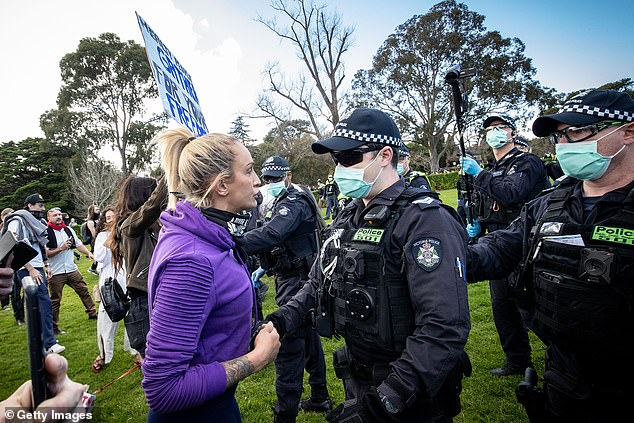 Incident:Photos from the protest show her clashing with a police officer on the grass of the Shrine of Remembrance
