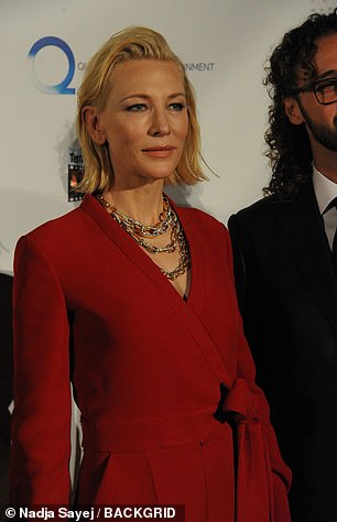 Accessorize: Cate's ensemble had a wrap design and she added a sparkling touch to the look by wearing a jeweled gold chain necklace