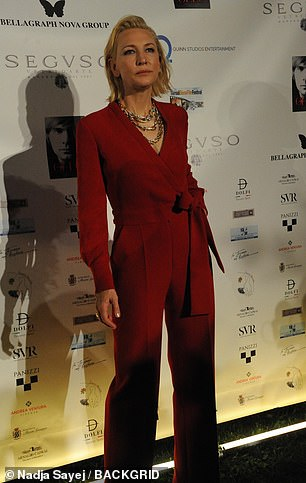 Stylish: The Lord of the Rings star boosted her sculptural figure in a pair of red heels