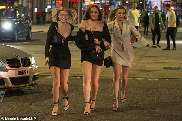 Revellers have a good time on the last weekend of August during the bank holiday in Soho, central London