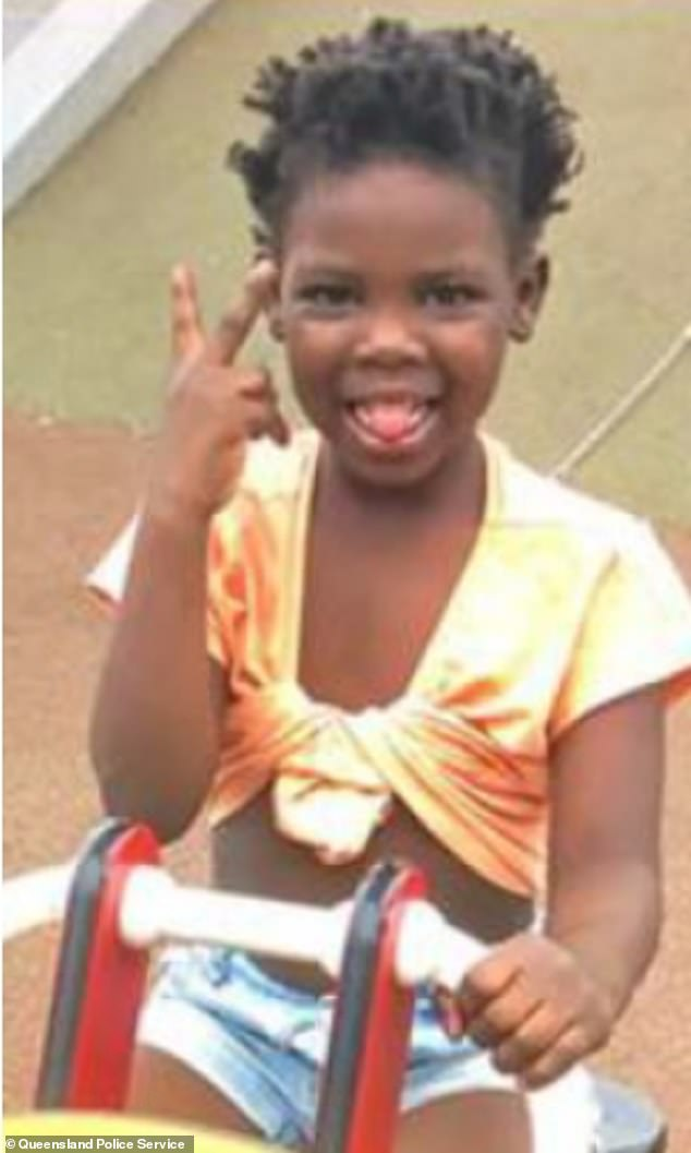 The seven-year-old girl is described as having a dark complexion with dark, dread-locked hair