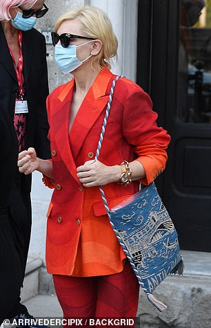 Safety first: Cate donned a face mask