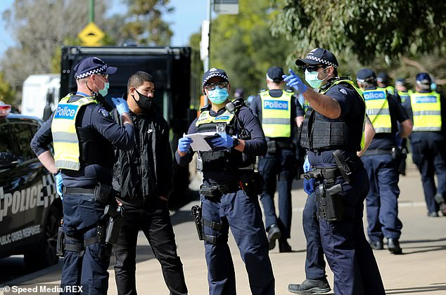 Police officers were out in force in Melbourne on Saturday to combat anti-lockdown protests.The Victorian Premier said he 'certainly hadn't heard or seen reports' of police officers covering their name tags and badges
