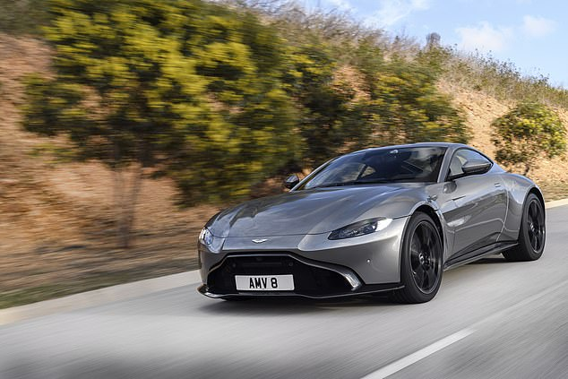 The luxury sports car is believed to be anAston Martin V8 Vantage (above), which reportedly costs around £124,000
