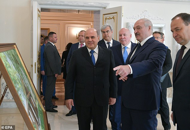 And amid warnings to Russia not to interfere in Belarus as thousands protest against its government. Pictured is the country's president Alexander Lukashenko (centre) with Russian prime minister Mikhail Mishustin (left)