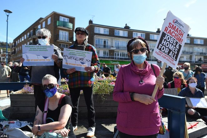Pro and anti-immigration protesters have gathered in Dover for a large demonstration today