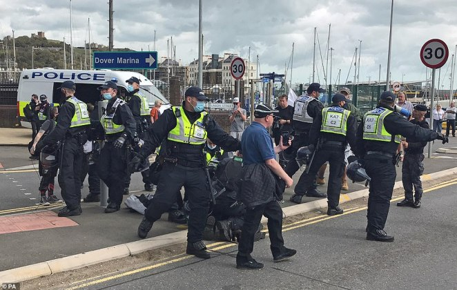 Several officers were seen restraining one person on the ground. At least 40 officers are at the scene by the A20, which remains blocked in both directions