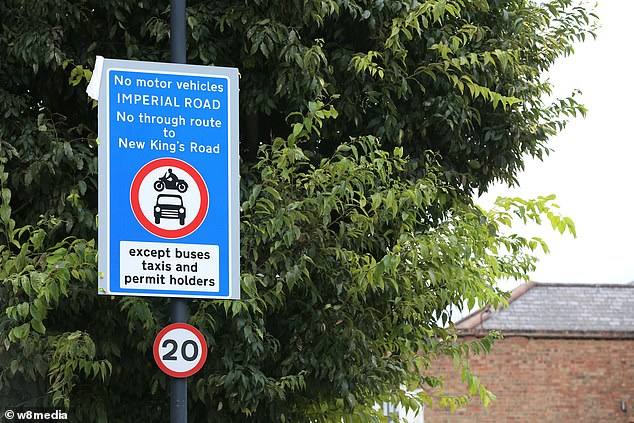 The council says the initiative in the upmarket West London area will stop local roads being used as a rat run, but residents and businesses have branded it a money making scheme