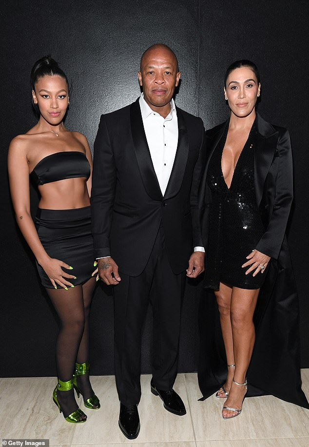 Stunning figures: Young says he expenses include $900K per month in entertainment costs, plus $135K for new clothes; shown with Dre and daughter Truly Young, 19, in February