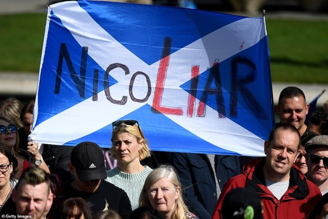 Another protestor holds up a sign reading 'NicoLiar' at the rally organised by the Saving Scotland Facebook group