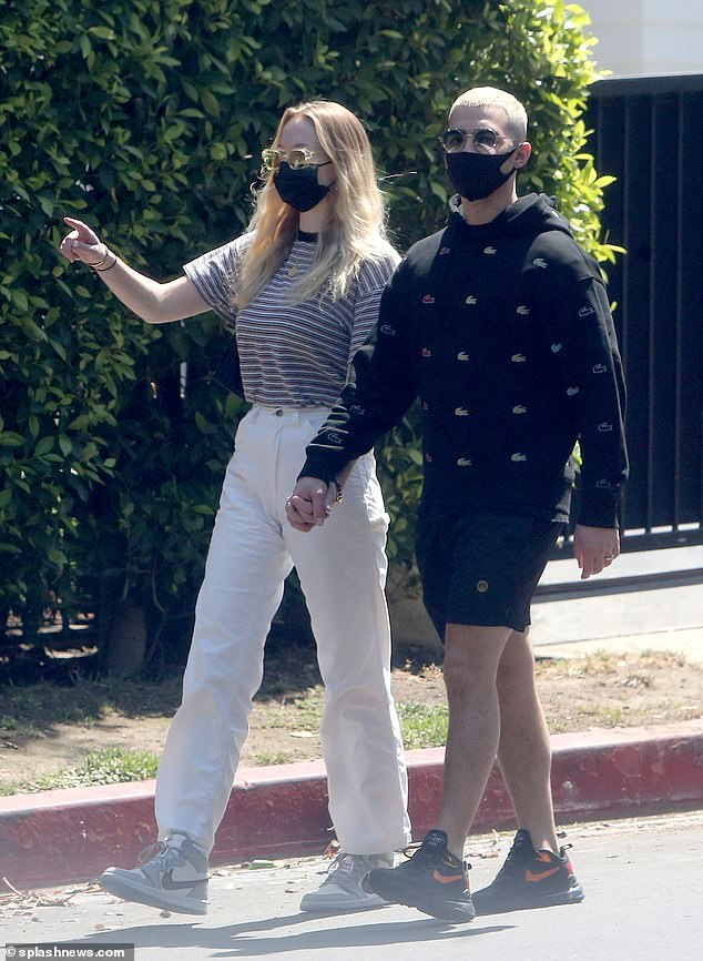 Bouncing: As they walked briskly, the 24-year-old Game of Thrones star showcased her slender post-pregnancy physique in a striped top, which she slipped into white jeans
