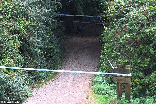 Pictured: Police cordon off public toilets and nearby woodland after a 3-year-old girl was abducted and sexually assaulted at a country park on the Isle of Wight on Bank Holiday Monday