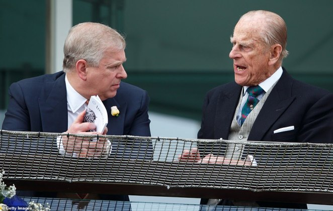 Prince Philip and Prince Andrew, the Duke of York, watch the racing from the balcony of the Royal Box as they attend Derby Day at Epsom Racecourse in June 2016. For Philip and the Queen, their son's failure of judgment was a tragedy