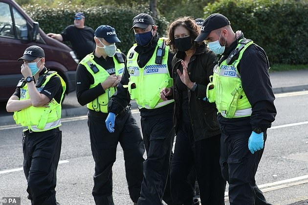 Typical of the activists was Gully Bujak, frogmarched from the Broxbourne blockade just off the M25 by police after sprawling on a blow-up mattress atop a van (pictured: one protester is led away by police outside the Newsprinters printing works at Broxbourne, Hertfordshire following demonstrations, September 5, 2020)